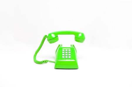 Green classic telephone on white background, phone ringing, phone floating in the air, waiting someone to receive phone call.