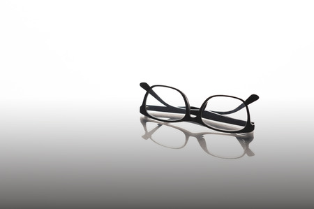Black frame eye glasses on mirror background, Reading,relaxing or breaking concept.