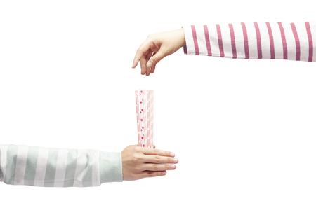 Hand holding straws for someone to draw straws, drawing straws isolated on white background, draw lots or lucky draw, business choosing concept.
