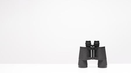 ฺVintage binoculars isolated on white background with texting space, travelling concept.