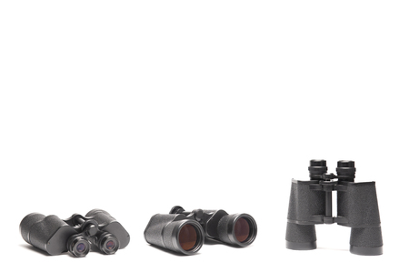 Three angles of vintage binoculars isolated on white background with texting space, travelling concept. Фото со стока