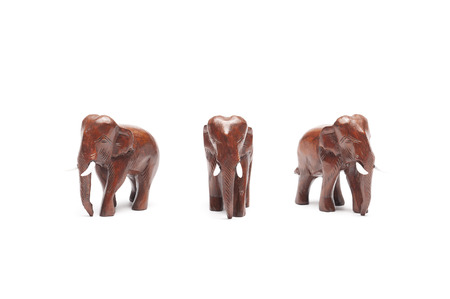 Three angles wooden Thai elephants isolated on white background.