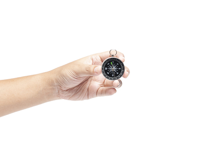 Hand holding compass isolated on white background, travelling or business direction concept with texting space. searching direction with compass.
