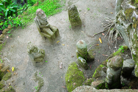 anthropomorphous: Ancient Indonesian sculptures carved from stone, Ambarita Stone Chairs, Lake Toba, Indonesia Stock Photo