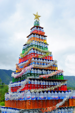 LAKE TOBA, INDONESIA, DECEMBER 2016 : Original Christmas Tree made of plastic bottles with colored water for New Years Eve celebration. Editorial