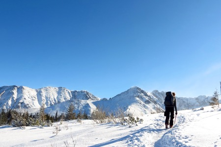 lone climber walking on the snowy mountains