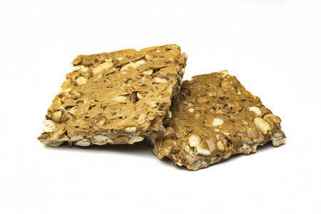 Jaggery and Peanut crispy bar called gajjak in india isolated on white background Stock Photo