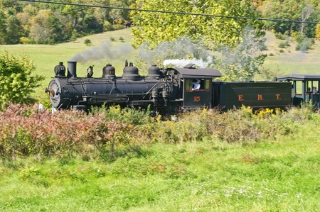 10082011 Orbisonia Pennsylvania during East Broad Top railroads fall extravaganza engine #15 a 1914 Baldwin mikado races along narrow gauge tracks pulling tourist on a sunny fall day