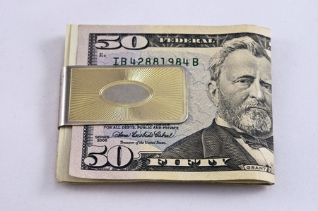 financal: Gold money clip and fifty dollar bill Stock Photo