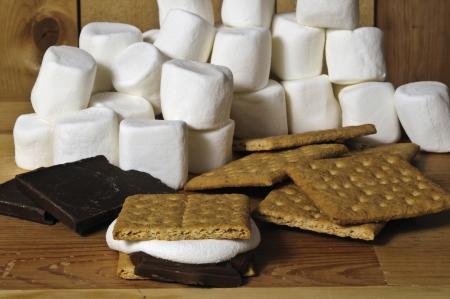 graham: chocolate marshmallows and graham crackers on wood background Stock Photo