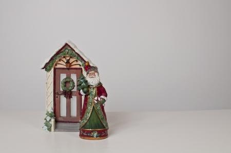 figurines: santa and door figurines on white background