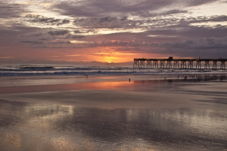sunrise at sunglo pier daytona beach florida photo