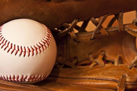 baseball pitcher: close up of baseball in leather baseball glove