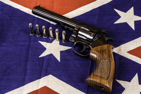 magnum: magnum handgun and bullets on confederate battle flag