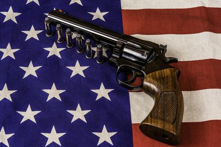 magnum: 357 magnum pistol and bullets on American flag