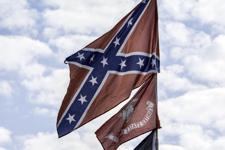 battle cross: confederate flag flying on sunny summer day