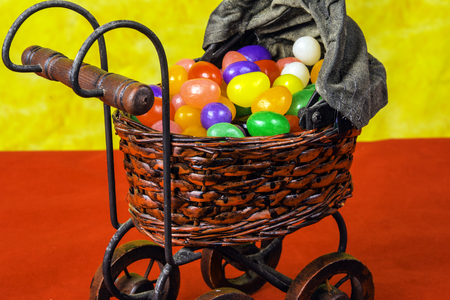 jelly beans: antique baby buggy full of jelly beans Stock Photo