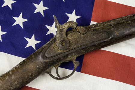 antique rifle: antique rifle on american flag