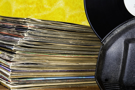 record album in auto cleaner next to record stack