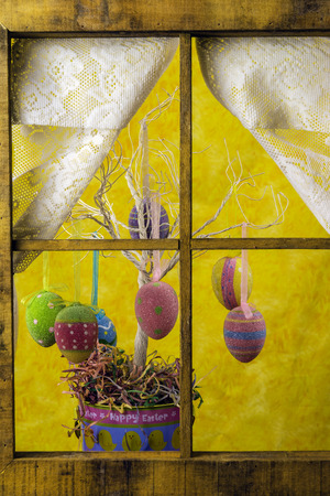 window curtains: Easter egg tree in wood frame window with lace curtains Stock Photo