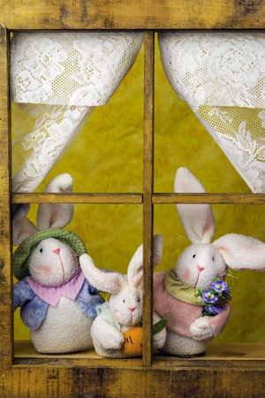 looking out: family of Easter bunnys  looking out window