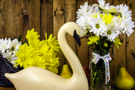 decoy: carved swan and fresh cut flowers