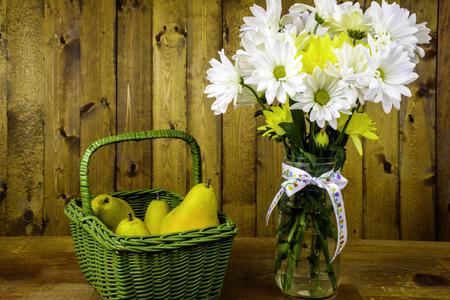 fruit basket: spring flower bouquet in glass mason jar and fruit basket