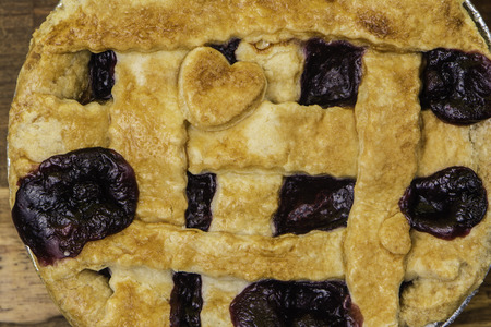 blueberry pie: close up blueberry pie with pastry heart cutout