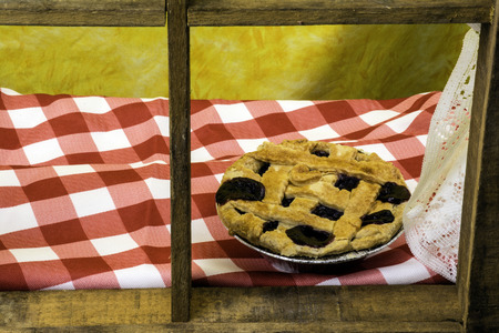 window sill: Blueberry pie cooling on window sill Stock Photo