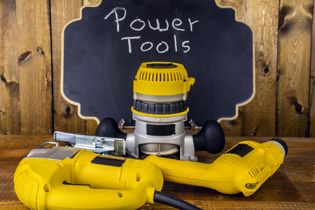 power tools: electric power tools on wood background