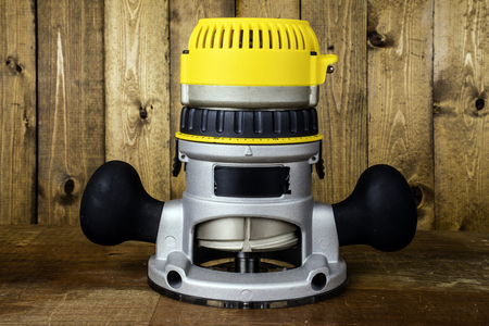 fixed: electric fixed base router on wood background