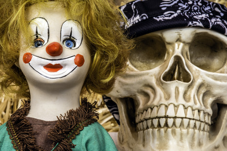 antique clown doll and human skull Stock Photo
