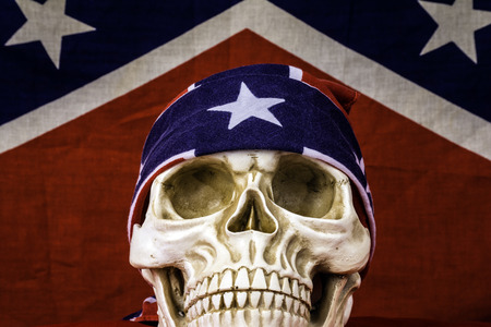 rebel flag: human skull in front of confederate flag