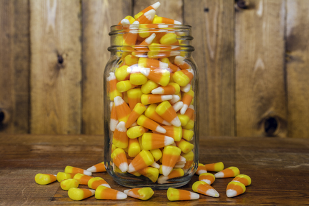 glass jar full of candy corn