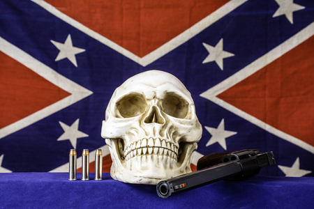 black flag: human skull and confederate flag Stock Photo
