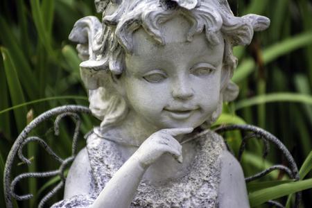 Garden Statue Of Young Girl Stock Photo   64584589