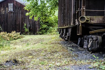 wood railways: abandon railroad car and old wood building