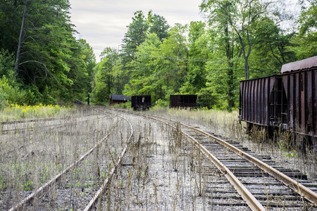 railroad tracks: abandon railroad tracks and coal cars Stock Photo
