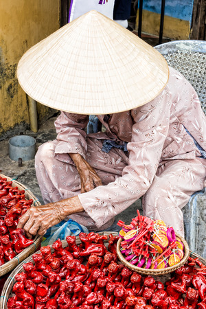 gewgaw: Street vendor selling at the market in Vietnam homemade ceramic figurine Stock Photo