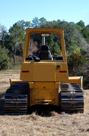 back view of bull dozer ready to clear the field.
