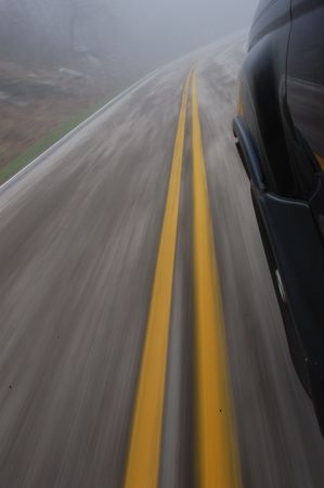 road blured due to car speeding Stock Photo