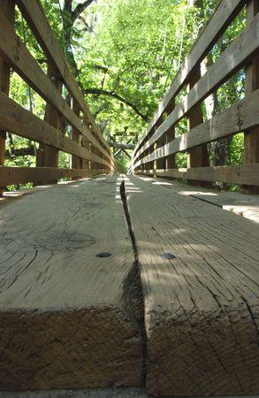 close up of wooden suspension bridge in park