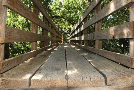 wooden suspension bridge in park Stock Photo