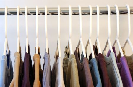 Shirts on hangers close up view