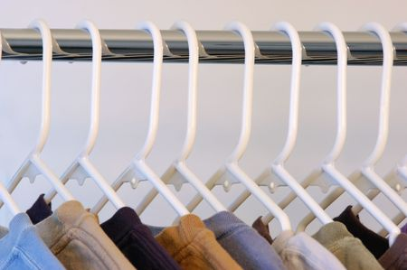 Shirts on white plastic hangers close up view Stock Photo - 4657484