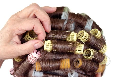 Senior citizen adjusting bobby pin Close up view back of the head hair roller curlers Stock Photo