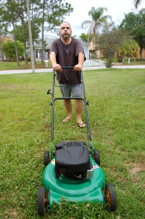 lawn mowing man Stock Photo - 4721994