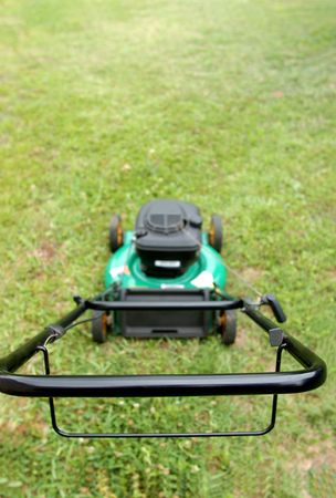 lawn mover on green grass ready to start mowing