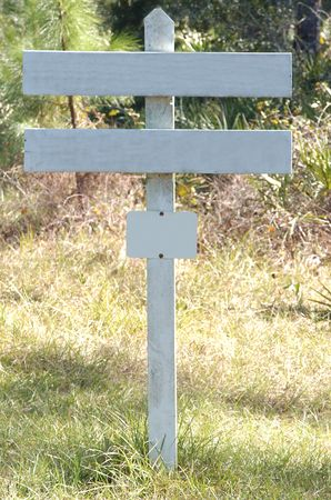 blank white wooden sign in forest
