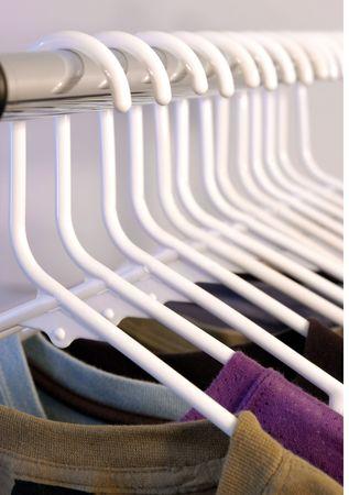 many shirts hung on white hangers Stock Photo - 4845762